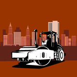 Road roller with buildings Royalty Free Stock Photography