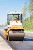 Road roller compact asphalt during road works Stock Photography