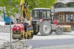 Road roller compacted asphalt. During the repair on the main street of Lvov on April 27, 2013 in Lvov, Ukraine Royalty Free Stock Images