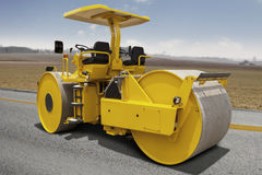 Road roller compacting asphalt Royalty Free Stock Image