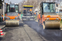 Road roller compacting asphalt Stock Photo