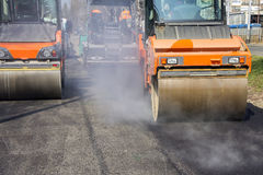Road roller compacting asphalt Royalty Free Stock Photo