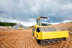 Road roller compacting soil Stock Photography