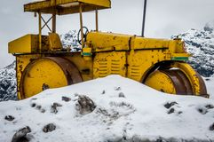 A road roller for constructing roads through the Himalayas in heavy snow at Sikkim, India. A road roller for constructing roads through the Himalayas in heavy royalty free stock photo