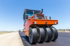 Road roller at road construction site royalty free stock photography