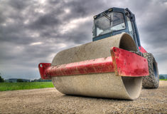 Road roller at dramatic angle Royalty Free Stock Photography