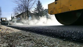 Road roller on hot asphalt