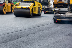 Road roller leveling fresh asphalt Royalty Free Stock Image