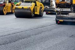 Road roller leveling fresh asphalt Royalty Free Stock Image