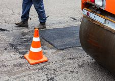 Road roller and traffic cone on the road construction Royalty Free Stock Photography