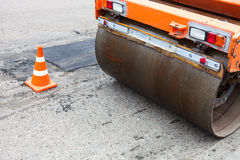 Road roller and traffic cone on the road construction Stock Photo