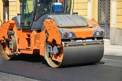 Road roller at work on the street Stock Photography