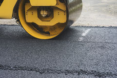 Road Roller While Working To crush the asphalt to condense. Royalty Free Stock Images