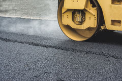 Road Roller While Working To crush the asphalt to condense. Royalty Free Stock Photos