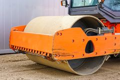 The road roller works on the construction site of a new building stock photos