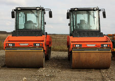 Road rollers. Parked road rollers at workplace royalty free stock image