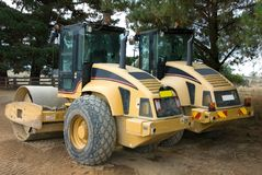 Road Rollers. Two road rollers, parked beside a newly constructed road royalty free stock images