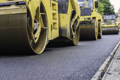 Road rollers compacting asphalt Royalty Free Stock Images