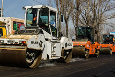Road rollers compacting fresh asphalt over the entire width of the roadway. KIEV, UKRAINE, MARCN, 2017:  Road rollers compacting fresh asphalt over the entire Royalty Free Stock Photography