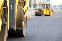 Road rollers compacting fresh asphalt Stock Photography