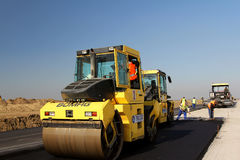 Road rollers leveling fresh asphalt pavement on a runway as part of the Danube Delta international airport expansion plan Stock Image