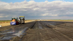 Road rollers leveling fresh asphalt pavement, time lapse stock footage