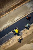 Road rollers working on the construction site aerial view Royalty Free Stock Image