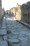 Road of rome. Characteristic road of ancient Rome with the old walls of the houses found all over the ruins of Pompeii destination for both tourism Royalty Free Stock Photos