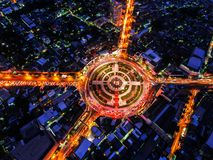 Road Roundabout With Car Lots Wongwian Yai In Bangkok,Thailand.street Large Beautiful Downtown At Night.Aerial View Cityscape. Royalty Free Stock Images