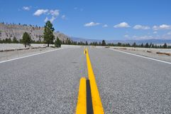 On the road on route 66. August 2013 - California (USA) - View of route 66 in a sunny day Royalty Free Stock Photo