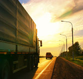 Road route blur truck russia. Road route blur truck golden sky Royalty Free Stock Images