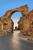 Road and ruins in Side, Turkey at sunset Stock Image