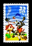Road Runner and Wile E. Coyote, Looney Tunes serie, circa 2000. MOSCOW, RUSSIA - NOVEMBER 24, 2017: A stamp printed in USA shows Road Runner and Wile E. Coyote royalty free stock images
