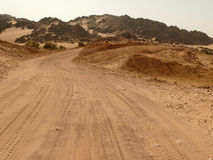 The road running through the Sahara desert. Royalty Free Stock Photos