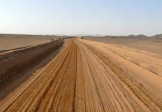The road running through the Sahara desert. Stock Photo