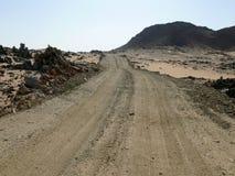The road running through the Sahara desert. Royalty Free Stock Photo