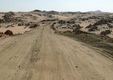 The road running through the Sahara desert. Stock Photography