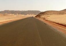 The road running through the Sahara desert. Stock Images