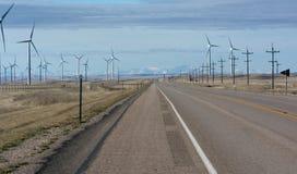 Road running Spinning wind turbines Stock Photo
