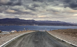 The road running to the Red Sea Stock Photography