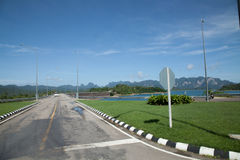 The road runs along the lake shore. The road runs along the lake Cheow Lan stock photography