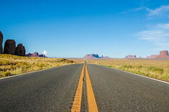 A road that runs through Monument Valley, USA Royalty Free Stock Images