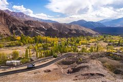 A road runs through it in the Valley. In Ladakh, India Stock Photo