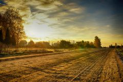 Road in rural district in autumn time Stock Image