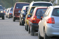 Road rush. Rush hour traffic lined up car by car on the downtown streets Stock Photo