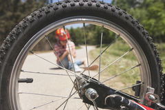 Road safety concept. Kids safety concept. Bicycle accident Royalty Free Stock Photo