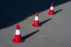 Road safety cones on asphalt. Road car safety cones on asphalt with sunny day royalty free stock image