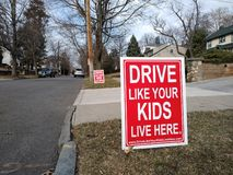 Road Safety, Drive Like Your Kids Live Here, Rutherford, NJ, USA. Signs asking drivers to slow down and drive safely through quiet, residential streets. This stock photos