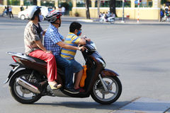 Road safety: A family on a moped Royalty Free Stock Photo