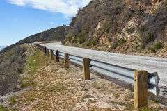 Road Safety Rail. Guard rail for an old narrow paved road Royalty Free Stock Photo